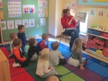 The preschoolers listing to book on animal sounds